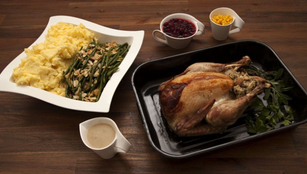 Turkey with almond beans, mashes potatoes and cranberrys